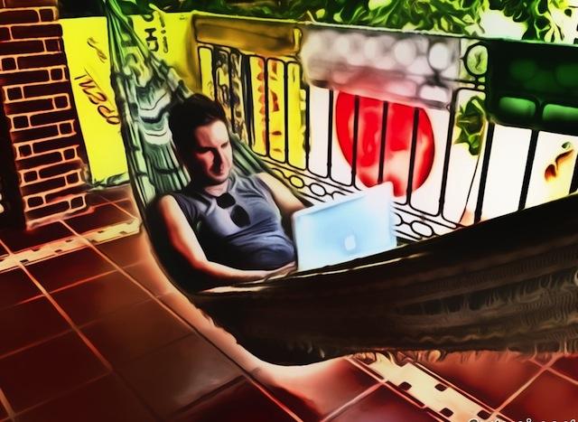 traveler working in hammock