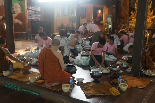 Monks selecting food