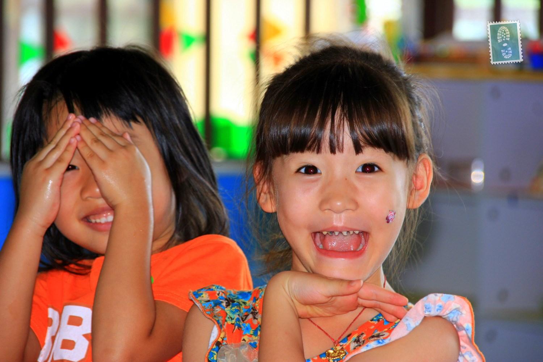 blind child making friends in kindergarden