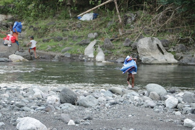 This little guy could wait to get home with this supplies to rebuild his family's home...he forded the river in the buff