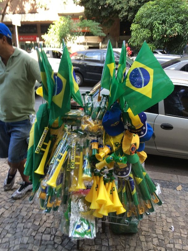Guy having a tough time unloading Brazil flags 2 days prior to the World Cup